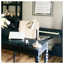 A keyboard is conveniently tucked behind desk for quick access...