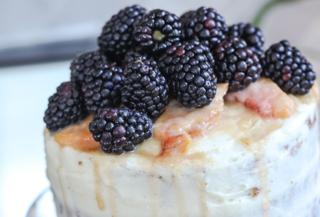 Peach Carrot Cake with Cream Cheese Frosting and Blackberry Garnish