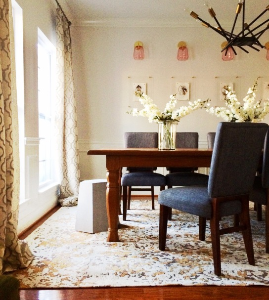 Dining Room with Pink Sconce Lighting